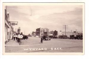 Real Photo, Main, Chevrolet and Mobiloil Signs, Bicycle, Wynyard, Saskatchewan