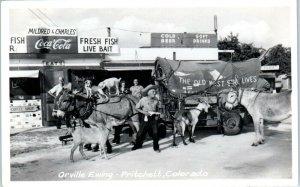 RPPC PRITCHETT, CO  Orville Ewing & COVERED WAGON CAFE c1950s Coca Cola Sign