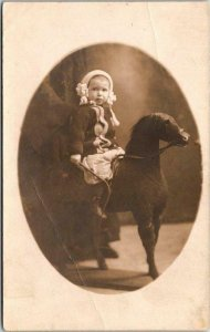 c1910s RPPC Studio Real Photo Postcard Little Girl w/ Whip on Stuffed Horse