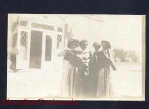 RPPC DELTA COLORADO DOWNTOWN STREET SCENE PRETTY WOMEN REAL PHOTO POSTCARD