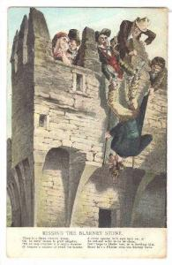 Kissing the Blarney Stone Poem, Holding man from feet while he kisses buildin...