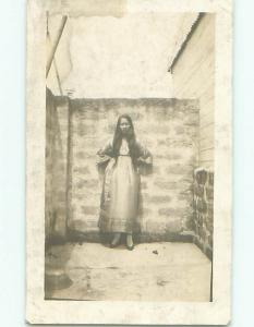 rppc Pre-1930 WOMAN WITH LONG HAIR STANDING BY THE BRICK WALL AC7835