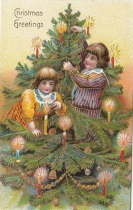 2 kids & CHRISTMAS Tree with candles , 1900-10s