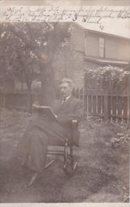 Man Posing In Chair Reading Book 1907 Coshocton Ohio  Real Photo