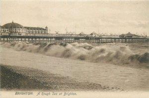 Postcard England Brighton  rough stormy sea near pier