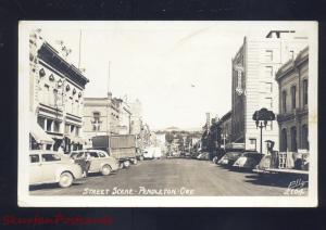RPPC PENDLETON OREGON DOWNTOWN MAIN STREET SCENE  CARS REAL PHOTO POSTCARD