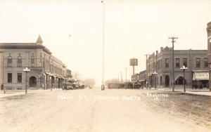 Paullina IA~Bank & Dry Goods Store~Corner Turret~Water Tower~Dirt Main RPPC 1914