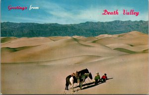 Greetings from Death Valley CA Horses Rider on Dunes Postcard unused 1950s