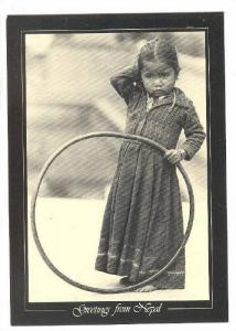 Girl with ring toy , Nepal , 60-70s