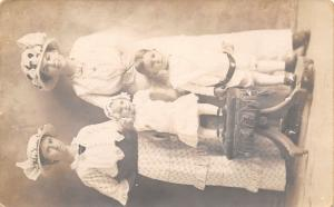 RPPC~Mom & Daughter w/White Hats~Toddler w/Bonnet on Chair~Black Belt Boy~c1910