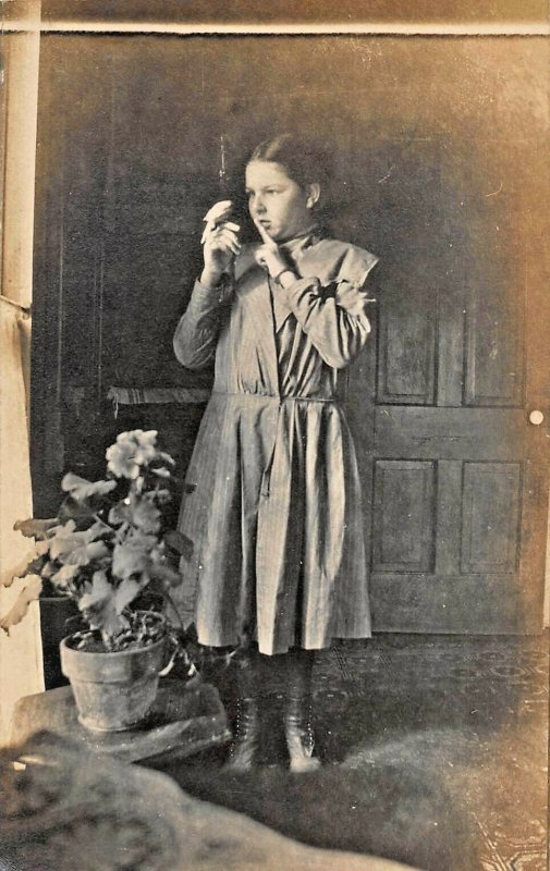 GIRL WITH SMALL BIRD PARAKEET ON HER HAND~1910s REAL PHOTO POSTCARD