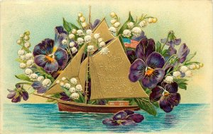 Many Happy Returns of the Day Sailboat Schooner Embossed Flowers 1910 Postcard