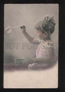 057383 Lovely Girl playing SOAP BUBBLES vintage Photo Tinted