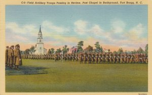 FORT BRAGG , North Carolina , 1944 ; Field Artillery Troops Passing in Review