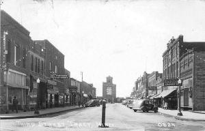 Tracy MN Storefronts Old Cars in 1940 RPPC Postcard