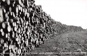 International Falls MN~Paper Mills Stack of Pulp Wood~Logs~RR Tracks~1940s RPPC