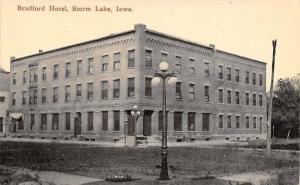 Storm Lake Iowa~Bradford Hotel~Dirt Road~5 Globe Lamp Posts~1908 Postcard