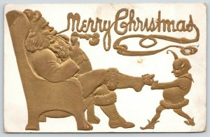 Christmas~Santa in Easy Chair~Pointy Haired Elf Pulls Boots~Gold Emboss~Airbrush