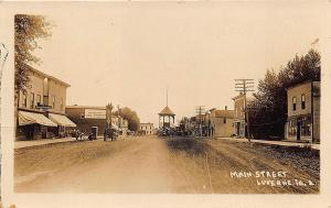 Lu Verne IA Main Street Storefronts Horse & Wagons Band Stand RPPC Postcard