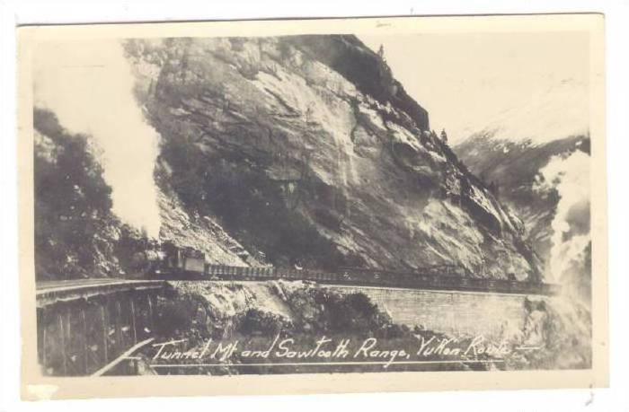RP: Train on Railroad Tracks , Tunnel Mt & Sawtooth Range, Yukon Route , Cana...