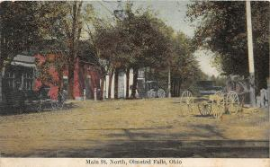F63/ Olmsted Falls Ohio Postcard c1910 Main Street Stores Wagon