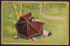 Man & Lady Kissing Behind an Umbrella Used c1911