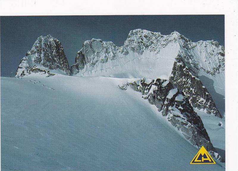 Skiers Lend Perspective To The Vast Terrain Encompassing Vowell Glacier In th...