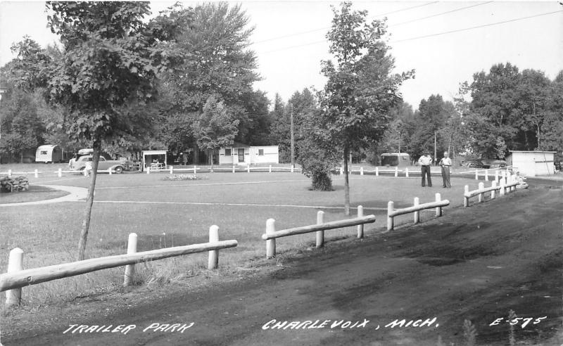 Charlevoix Michigan~Trailer Park~Men in Fenced in Lot~RV~1940s RPPC