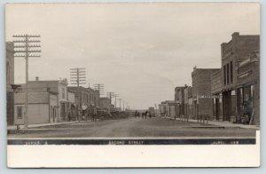 Laurel NE~Second Street~Furniture Store~Advocate Newspaper Office~Tank~1912 RPPC