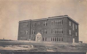Isn't It a Lonesome Looking Building? Here I Go To School~Sit by Light RPPC 1914