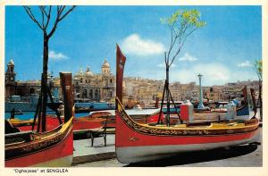 Malta Dghajsas at Senglea with the city of Vittoriosa