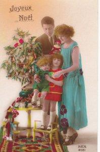 RP; Christmas tree & girl holding giant doll , 00-10s