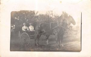 Real Photo Postcard~Victorian Family in Horse Buggy~Baby on Lap~Nice Hat~1912