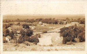G62/ Elk Mountain Wyoming Postcard RPPC 1914 Homes Barns