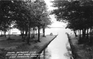 Lake Cadillac-Mitchell Michigan~Canal Leading to Lake~Swimmers/Boats~1940s RPPC