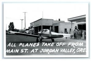 Postcard Planes Take Off from Main St, Jordan Valley OR Coca Cola 1950+ RPPC I21