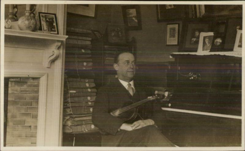 Man Sits w/ Violin & Piano - Bound Books on Shelves c1910 Real Photo Postcard
