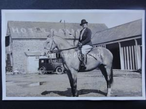 LADY ON HORSE BACK IN HOTEL GARAGE COURTYARD early RP Postcard