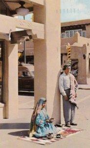 Santa Fe , New Mexico , 1959 ; Indians selling wares