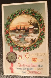 Vintage 1910 embossed and gilded Christmas greeting postcard with stamp