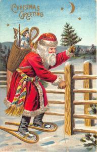 Christmas Greetings Red Suited Santa Claus Basket Fence Tree Postcard
