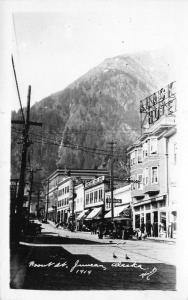 Juneau: Alaska Hotel & Cafe~Roof Sign~Bay Windows~Pigeons on Street~RPPC 1920s