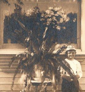 c1910 RPPC Boy Flour Advertising Cap Fern Floral Window Display Real Photo