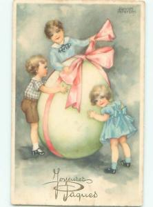 foreign Old Postcard signed EUROPEAN KIDS WITH GIANT EASTER EGG AC2466