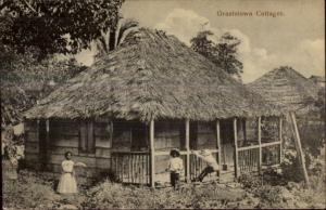 Publ in Nassau Bahamas - Grantstown Cottage Black Children c1905 Postcard