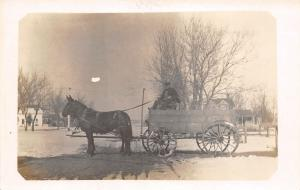 Real Photo Postcard~Delivery Man on High Seat~Horse Wagon~Snow~Homes~c1912 RPPC