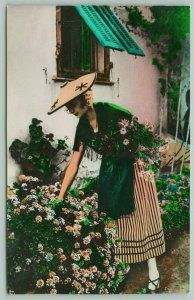 Monte Carlo IT Colorized RPPC~Turquoise Shutters~Lovely Lady Picks Flowers 1950