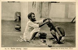 India - Jaipur. Barber Shaving a Man