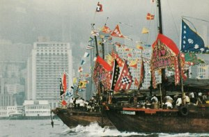 SINGAPORE , 1950-70s ; Tin Hau Festival Boats pass The Mandarin Hotel