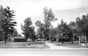 Houghton Lake Michigan~Whispering Pines Modern Log Cottages~Swingset~1950s RPPC